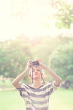 Beauty Girl Outdoors. Hold old camera in park. Beautiful Teenage Model stock photography