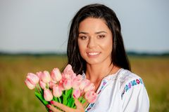 Beauty Girl Outdoors enjoying nature. Beautiful Teenage Model gi Royalty Free Stock Images
