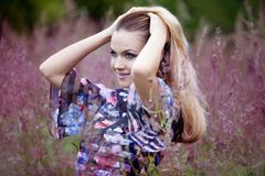 Beauty Girl Outdoors enjoying nature, blond girl Royalty Free Stock Images