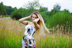 Beauty Girl Outdoors enjoying nature, blond girl Stock Images