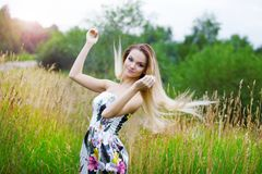 Beauty Girl Outdoors enjoying nature, blond girl Stock Photography