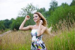 Beauty Girl Outdoors enjoying nature, blond girl Stock Image