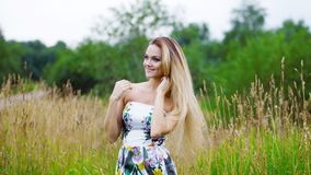 Beauty Girl Outdoors enjoying nature, blond girl Royalty Free Stock Image