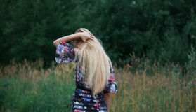 Beauty Girl Outdoors enjoying nature, blond girl Stock Photo