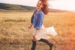 Beauty girl outdoors enjoying nature. Free happy woman Royalty Free Stock Image
