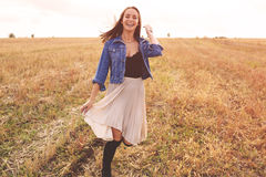 Beauty girl outdoors enjoying nature. Free happy woman Stock Photos