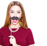 Beauty girl with paper glasses on stick showing empty copyspace Royalty Free Stock Images