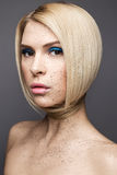Beauty girl with a perfectly straight hair and creative makeup. Beauty face. Photo was made in studio Stock Photo