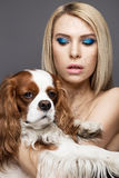 Beauty girl with a perfectly straight hair and a dog. Beauty face. Photo was made in studio Stock Photos