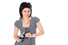 Beauty girl photographer in sailor's vest with photo camera Stock Images