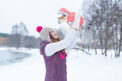 Beauty girl playing with little dog chihuahua. In winter park Royalty Free Stock Photography