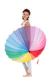 Beauty girl playing with multy color umbrella. Isolated on white background Royalty Free Stock Photos