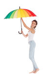 Beauty girl playing with multy color umbrella. Isolated on white background Royalty Free Stock Photo