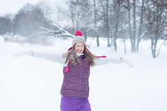 Beauty girl playing with snow outdoors Stock Images