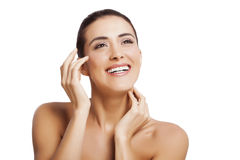 Fresh clean face. Beautiful young woman touches the fresh clean skin on her face Stock Photos
