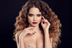 Beauty girl portrait. Beautiful young woman with long curly hair Royalty Free Stock Photo