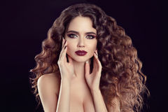 Beauty girl portrait. Beautiful young woman with long curly hair Royalty Free Stock Photos