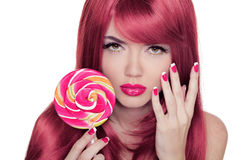 Beauty Girl Portrait holding lollipop with Colorful Makeup, Colo. Ring Pink Hair, Manicured nails royalty free stock image