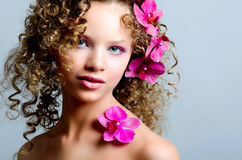 Beauty girl portrait with purple orchid Stock Images