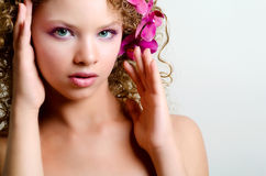 Beauty girl portrait with purple orchid Royalty Free Stock Photos