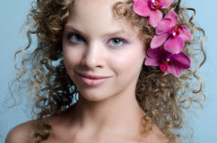 Beauty girl portrait with purple orchid Stock Photo