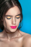 Beauty Girl Portrait with Vivid Makeup. Fashion Woman portrait close up on blue background. Bright Colors. Manicure Make up. Smoky Stock Images