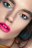 Beauty Girl Portrait with Vivid Makeup. Fashion Woman portrait close up on blue background. Bright Colors. Manicure Make up. Smoky Stock Photos