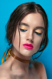 Beauty Girl Portrait with Vivid Makeup. Fashion Woman portrait close up on blue background. Bright Colors. Manicure Make up. Smoky Stock Image