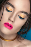 Beauty Girl Portrait with Vivid Makeup. Fashion Woman portrait close up on blue background. Bright Colors. Manicure Make up. Smoky Royalty Free Stock Images
