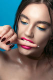 Beauty Girl Portrait with Vivid Makeup. Fashion Woman portrait close up on blue background. Bright Colors. Manicure Make up. Smoky Royalty Free Stock Image