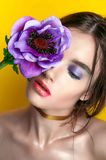 Beauty Girl Portrait with Vivid Makeup. Fashion Woman portrait close up on yellow background. Bright Colors. Manicure Make up. Smo Royalty Free Stock Photography