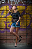 Beauty girl posing fashion near red brick wall on the street Royalty Free Stock Photography