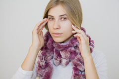 Beauty girl in purple lapin scarf toucing skin Royalty Free Stock Image