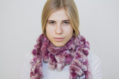 Beauty girl in purple lapin scarf Stock Photography
