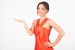 Beauty girl in red dress gesturing. Over white background Royalty Free Stock Photos