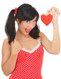 Beauty girl with red heart-shaped pepper Stock Photos