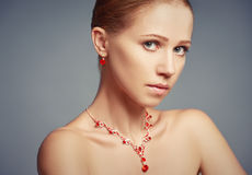 Beauty girl with red jewelry necklace and earrings Stock Photography