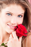 Beauty girl with red rose Royalty Free Stock Image