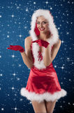 Beauty girl in a red santa claus dress with Stock Images