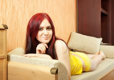Beauty girl relaxing on sofa Royalty Free Stock Image