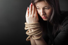 Bound hands. Beauty girl with rope on hand Stock Photo