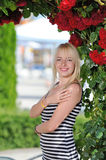 Beauty girl with roses arch Stock Photos
