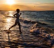 Beauty girl run on beach Stock Photo