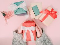 Beauty girl`s hand hold red present box with wraping by shiny pa Royalty Free Stock Image
