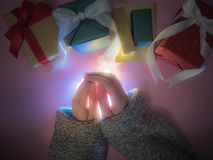 Beauty girl`s hand with winter cloth , light and group of gift b Royalty Free Stock Photos