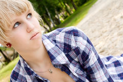 Beauty girl in the sand Stock Photography