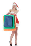 Beauty girl in santa hat with color bag Stock Photos