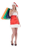 Beauty girl in santa hat with color bag Stock Images