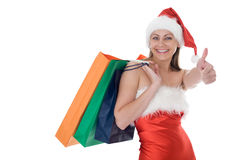 Beauty girl in santa hat with color bag Stock Image