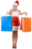 Beauty girl in santa hat with color bag Stock Photo